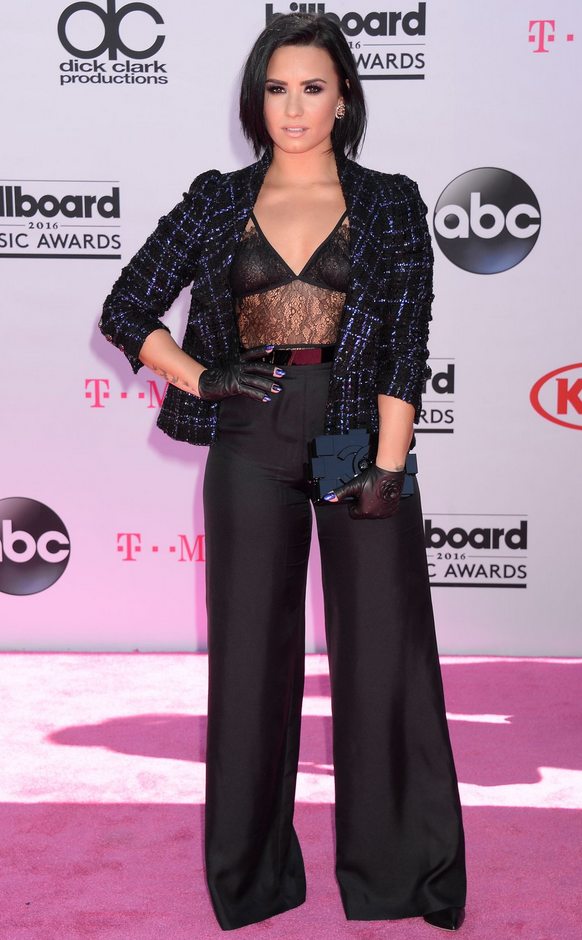 Demi Lovato in wide legs pants and lace